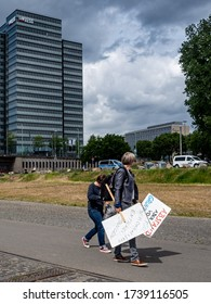 Cologne, Germany, 23 May 2020. People carrying signs on their way to public demonstration against Corona virus restrictions.
