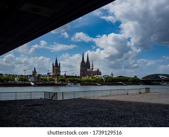 Cologne, Germany, 23 May 2020. Skyline of Cologne with Cathedral and Hohenzollern Bridge seen from under Deutzer Brisge.