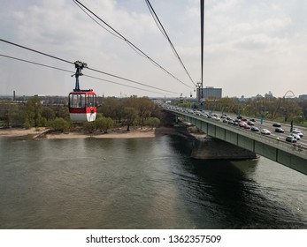 Cologne, Germany, 6 April 2019.  Cars approaching the city via Mülheim bridge seen from a cable car on a sunny spring day