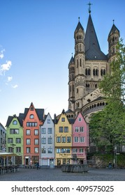 """COLOGNE, GERMANY - APRIL 14: Colorful houses and the roman Church """"Gross Sankt Martin"""" in the old town of Cologne, Germany."""
