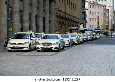 COLOGNE, GERMANY - APRIL 17,2018:  German taxi cab rank queue, Mercedes Benz and Volkswagen are most popular vehicle used as a taxi in Germany.