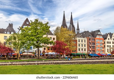 COLOGNE, GERMANY - APRIL 27: Buildings along an embankment and the High Cathedral of St. Peter in Cologne on April 27, 2012 in Germany.