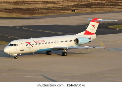 COLOGNE, GERMANY - APRIL 9, 2015: Austrian Airlines Fokker 100 (old livery) with registration OE-LVF  taxiing to terminal.