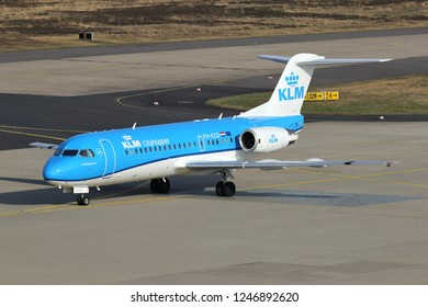 COLOGNE, GERMANY - APRIL 9, 2015: KLM cityhopper Fokker 70 with registration PH-KZD  taxiing to terminal.