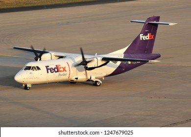 COLOGNE, GERMANY - APRIL 9, 2015: FedEx Feeder ATR 42F with registration EI-FXB on the ramp of Cologne Bonn Airport.