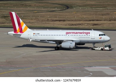 COLOGNE, GERMANY - APRIL 9, 2015: Germanwings Airbus A319-100 with registration D-AGWD on pushback at Cologne Bonn Airport.