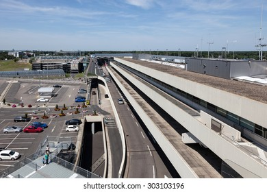 COLOGNE, GERMANY - AUG 1: View of passenger terminal and parking lot of the Cologne Bonn international Airport (CGN). August 1, 2015 in Cologne, Germany