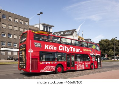 COLOGNE, GERMANY - AUG 7, 2016: Red sightseeing bus in the city of Cologne. North Rhine-Westphalia, Germany