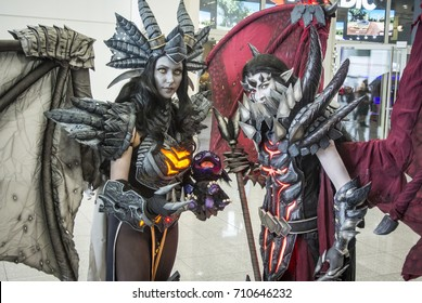 Cologne, Germany, August 22th, 2017: Gamescom 2017: cosplayers: Celestra and Onyxia (World of Warcraft)