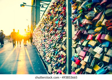 Cologne, Germany - August 23 2016: Declarations of Love. The fence between the trains and the pedestrians on a Cologne bridge has become a place to make a declaration of love with a padlock.