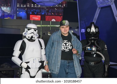 Cologne, Germany - August 24, 2017: A gamer posing with two star wars actors for the game star wars battlefront II at Gamescom 2017. Gamescom is a trade fair for video games held annually in Cologne.