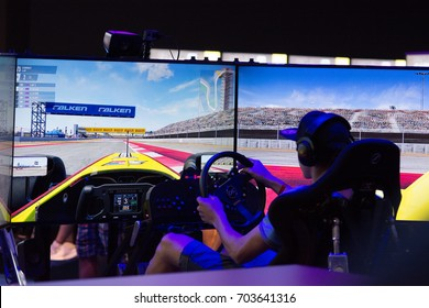 Cologne, Germany - August 24, 2017 - Young people at worlds biggest trade show for video games Gamescom in Cologne playing new game Project Cars 2
