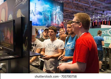 Cologne, Germany - August 24, 2017 - Young people at worlds biggest trade show for video games Gamescom in Cologne playing new games and walking around