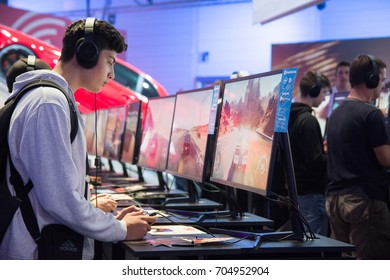 Cologne, Germany - August 26, 2017 - Young people at worlds biggest trade show for video games Gamescom in Cologne playing new games and walking around