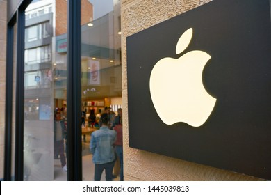 COLOGNE, GERMANY - CIRCA OCTOBER, 2018: close up shot of Apple sign at a store in Cologne.