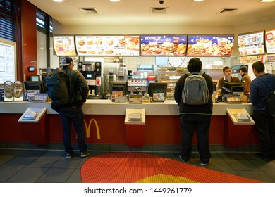 COLOGNE, GERMANY - CIRCA SEPTEMBER, 2018: counter service at a McDonald's restaurant in Cologne.