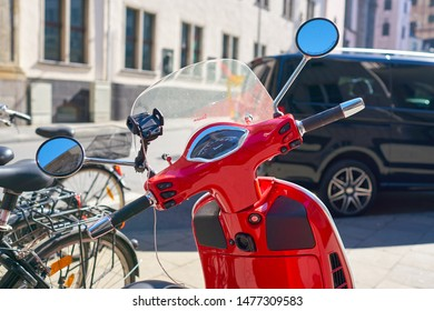 COLOGNE, GERMANY - CIRCA SEPTEMBER, 2018: red Vespa seen in Cologne. Vespa is an Italian brand of scooter manufactured by Piaggio.