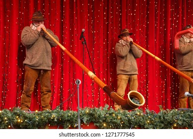 COLOGNE, GERMANY - DEC 17, 2018 - Alpine horn players at public concert at the Christmas market,Cologne, Germany