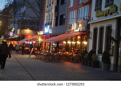 COLOGNE, GERMANY - DEC 17, 2018 - Evening lights of restaurants near the Christmas market,Cologne, Germany