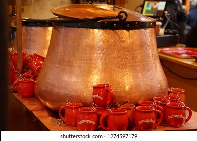 COLOGNE, GERMANY - DEC 17, 2018 - Large copper urn for gluwein and cider with cups, Christmas market,Cologne, Germany