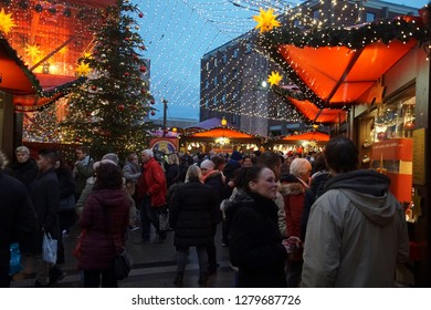COLOGNE, GERMANY - DEC 17, 2018 - Visitors in early evening explore the Christmas market,Cologne, Germany
