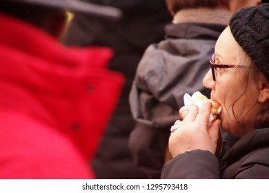 COLOGNE, GERMANY - DEC 17, 2018 - Eating a snack at the Christmas market,Cologne, Germany