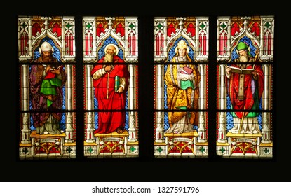 COLOGNE, GERMANY - DEC 17, 2018 - Stained glass windows and Gothic columns of the Cathedral in Cologne, Germany
