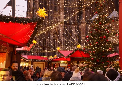 COLOGNE, GERMANY - DEC 17, 2018 - Visitors in early evening sample the food as they explore the Christmas market,Cologne, Germany