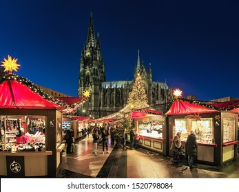 COLOGNE, GERMANY - DECEMBER 10, 2018: Cologne Cathedral Christmas Market in dusk. This is the most popular and best-known of all the city markets in front of the famous Cologne Cathedral.