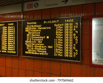 Cologne, Germany - December 2017 : The led screen showing the train schedule at the end of the year in koln messe deutz station.