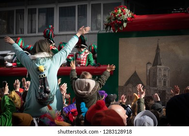 COLOGNE, GERMANY, FEBRUARY 12, 2018, Cologne street carnival, woman and little boy on shoulders raising their arms to the float Altstädter Köln Traditionskorps