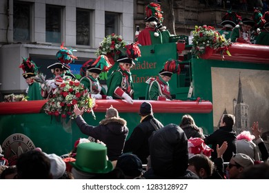 COLOGNE, GERMANY, FEBRUARY 12, 2018, Cologne street carnival, Altstädter Köln 1922 eV – Traditionskorps, men and women on a large float throwing flowers to the crowd 2