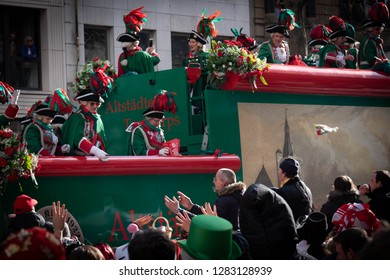 COLOGNE, GERMANY, FEBRUARY 12, 2018, Cologne street carnival, Altstädter Köln 1922 eV – Traditionskorps, men and women on a large float throwing flowers to the crowd 1