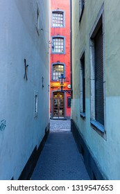 Cologne, Germany - February 16, 2019: narrow alley in the historic old town of Cologne. It is the largest city of Germans most populous federal state North Rhine-Westphalia