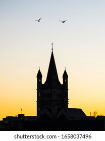 Cologne, Germany - February 17th 2020: The silhouette of the tower of Great St. Martin Church in the historic city of Cologne in Germany.