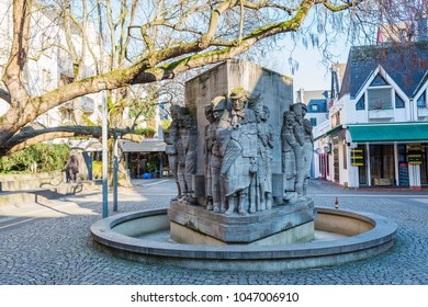Cologne, Germany - February 24, 2018: Willi Ostermann fountain memorial in the old town of Cologne. Ostermann was a lyricist, composer and singer of carnival songs and songs about Cologne