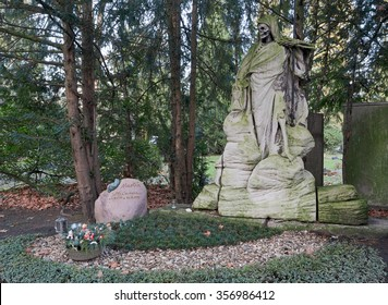 """COLOGNE, GERMANY - JANUARY 01: The """"Sensenmann"""" is the emblem on the Cologne Cemetery Melaten. COLOGNE on JANUARY 01."""