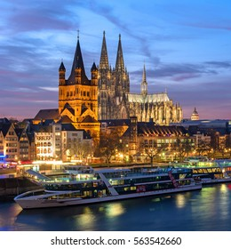 Cologne, Germany - January 22, 2017: View Church of Gross St. Martin., the Cathedral and the Rhine promenade.