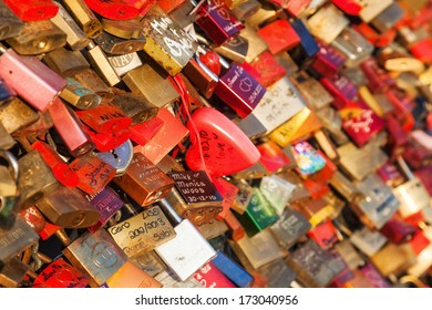 COLOGNE, GERMANY - JANUARY 22: love locks at the railing of the Hohenzollern Bridge on January 22, 2014 in Cologne. Loving couples locking a lock at the fence and throwing the key in the river rhine.