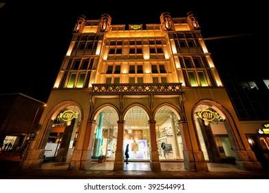 COLOGNE, GERMANY - JANUARY 27, 2009: 4711 building facade illuminated at night