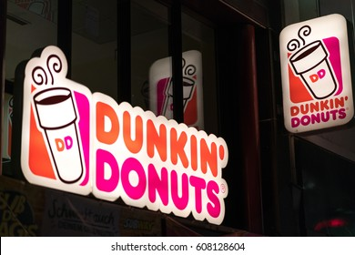 Cologne, Germany - January 29, 2017: Dunkin' Donuts shop. Founded in 1950, Dunkin' Donuts is an American global donut company and coffeehouse chain with more than 10,000 locations in 32 countries