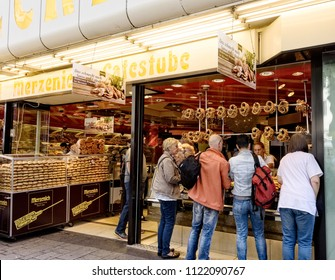 Cologne, Germany - July 15, 2017:  Customers buying bakery goods at a bakery in Cologne, Germany.