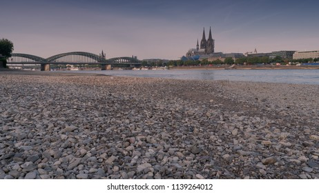 COLOGNE, GERMANY - JULY 20, 2018: Prolonged drought in Germany, low water of the Rhine river in Cologne at early morning time on July 20, 2018 in Germany
