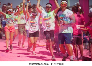 COLOGNE, GERMANY - JULY 23: crowds of unidentified people at the Color Run on July 23, 2013 in Cologne, Germany. The Color Run is a worldwide hosted fun race with about 9000 competitors in Cologne.
