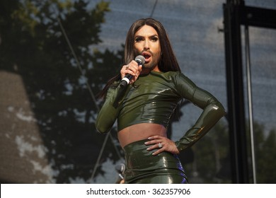 Cologne, Germany- July 4,2015: Conchita Wurst performs on the main Cologne Pride stage at the Heumarkt in 38 centigrade heat. Wurst is the winner of Eurovision Song Contest 2014