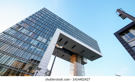 Cologne Köln, Germany June 1, 2019 Modern glass architecture looking up at office building with wiede angle
