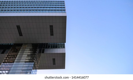Cologne Köln, Germany June 1, 2019 standing parallel next to finacial Kranhaus looking upt to clear sky