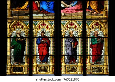 COLOGNE, GERMANY - JUNE 12, 2012 : Stained glass window depicting the Four Evangelists, Saint Matthew, Saint Mark, Saint Luke and Saint John, in Cologne Cathedral