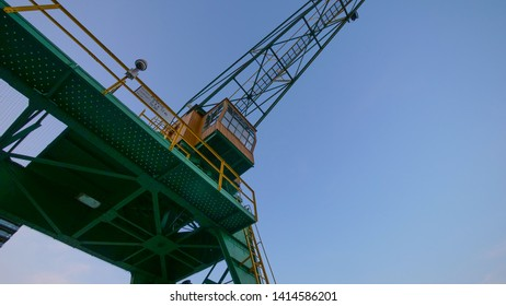 Cologne Köln, Germany June 1,2019  Historical old crane in old ship port with clear blue backround looking up