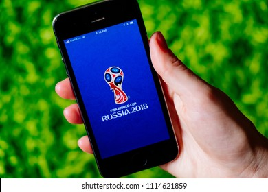 COLOGNE, GERMANY - JUNE 17, 2018: Closeup of iPhone screen with FOOTBALL WORLDCUP 2018 LOGO in Russia